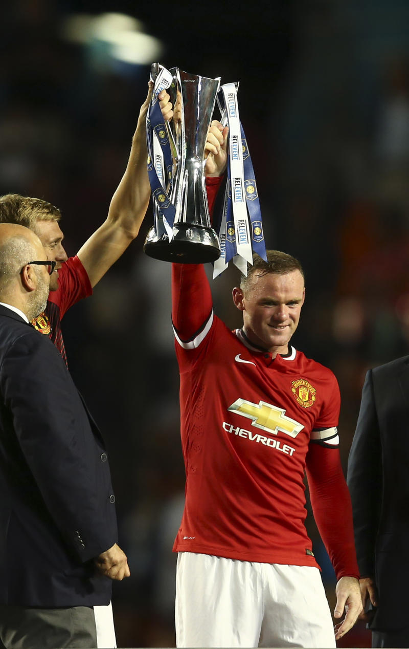 Mata, Rooney lift United to Cup title