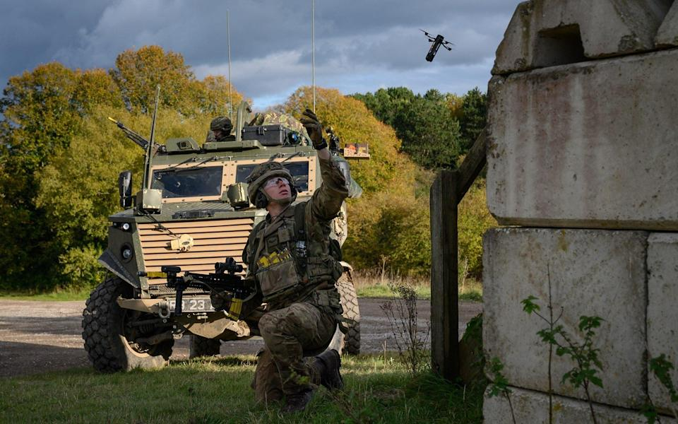 A soldier from the Royal Anglian Regiment launches drone during a training exercise on Salisbury Plain