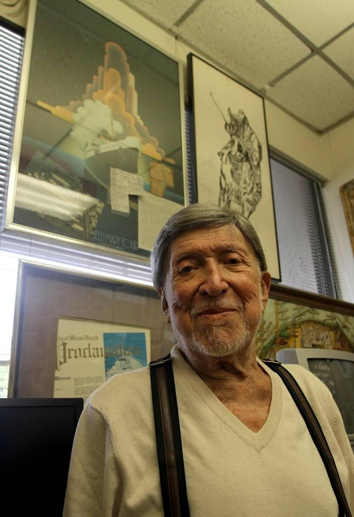 Ben Grenald poses in his office in Miami Shores in 2013 in front of a painting of the Queen Mary ship.