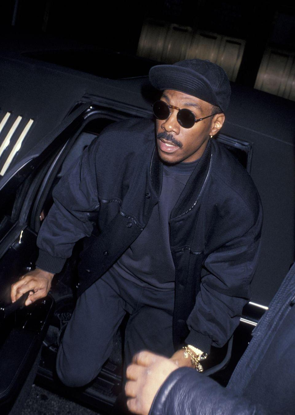 <p>Eddie Murphy emerges from a limousine, dressed in an all-black outfit, for a <em>Saturday Night Live </em>after-party. The comedian was a cast member on the sketch comedy show from 1980 until 1984, and his career skyrocketed afterward. </p>