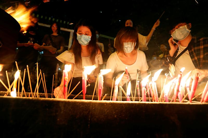 Anti-extradition bill protesters burn joss sticks in solidarity with those injured in the previous protests during a rally at Sha Tin district in Hong Kong China