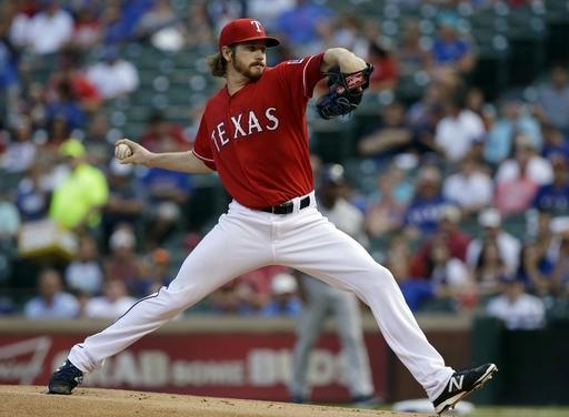 Texas Rangers starting pitcher Miles Mikolas works against the Houston Astros in the first inning of a baseball game, Monday, July 7, 2014, in Arlington, Texas. (AP Photo/Tony Gutierrez)