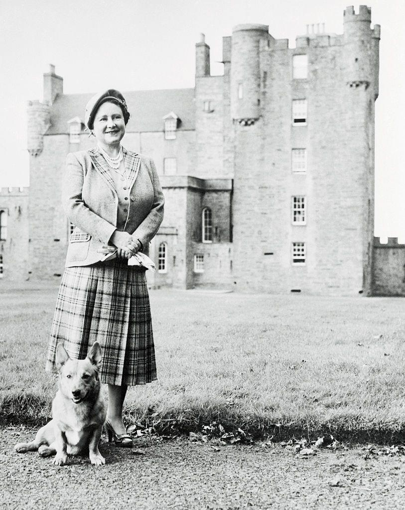 "<p>While still grieving the loss of her husband, the Queen Mother purchased the Castle of Mey on the coast of Scotland. Here, she poses outside of the residence with her dog, Honey, after finishing her <a href=""https://www.castleofmey.org.uk/about/history"" rel=""nofollow noopener"" target=""_blank"" data-ylk=""slk:extensive renovations on the property"" class=""link rapid-noclick-resp"">extensive renovations on the property</a> in 1955. </p>"