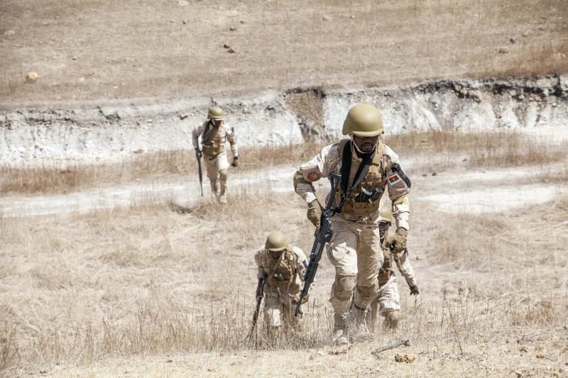 In this Tuesday Feb. 18, 2020, photo, Burkina Faso paratroopers commando exercise under the supervision of Dutch special forces during U.S. military-led annual counterterrorism exercise in Thies, Senegal. More than 1,500 service members from the armies of 34 African and partner training nations have assembled for the Flintlock exercises in Senegal and Mauritania, the two countries in West Africa's sprawling Sahel region that so far have not been hit by violence from extremists linked to al-Qaida or the Islamic State group. (AP Photo/Cheikh A.T Sy)