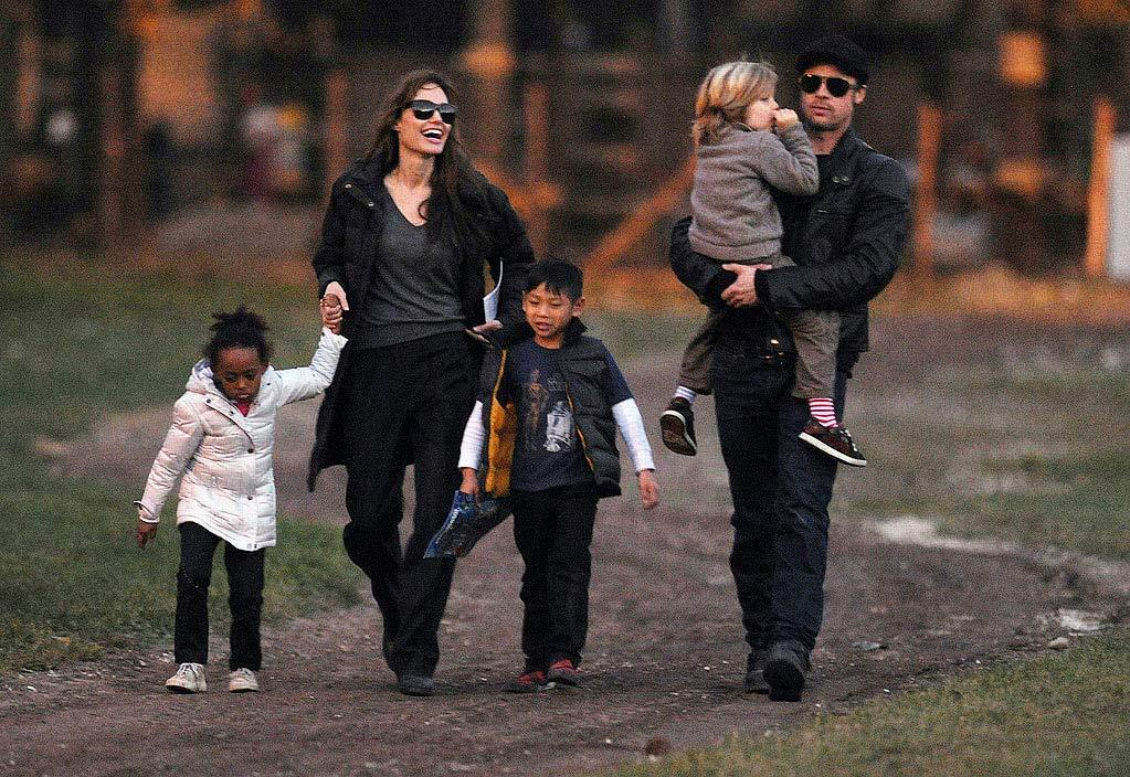 """In a cover story titled """"Brad & Angie's Kids Turn Violent,"""" the <i>National Enquirer</i> reports that Brad Pitt and Angelina Jolie's children are a """"brawling mini-mob."""" The mag goes on to say the couple's home has """"become a war zone, with kids screaming, punching, and scratching each other."""" According to the <i>Enquirer</i>, Maddox enjoys """"knife play,"""" which adds """"a horrifying element of danger to the boys' skirmishes."""" For how scarily dangerous it is in the Jolie-Pitt house, check out what an insider admits to <a href=""""http://www.gossipcop.com/maddox-pax-violent-shiloh-zahara-fight-fighting-pitt-jolie-family/"""" target=""""new"""""""">Gossip Cop</a>. <a href=""""http://www.splashnewsonline.com"""" target=""""new"""">Splash News</a> - November 5, 2010"""