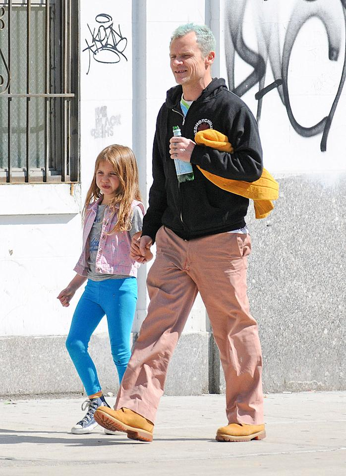 Meanwhile, Kiedis' bandmate Flea hit the city streets with his 6-year-old daughter Sunny. The bassist's blue hair was nicely coordinated with the little girl's pants. (5/6/2012)
