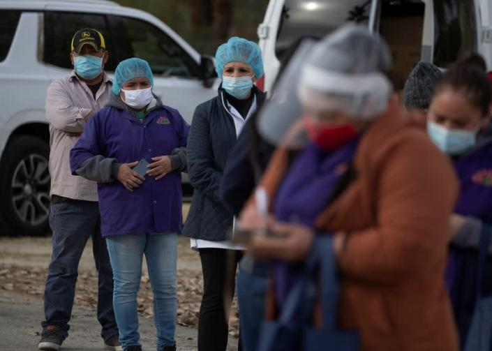 Farmworkers line up to receive vaccinations during the outbreak of the coronavirus disease (COVID-19) in Mecca, California