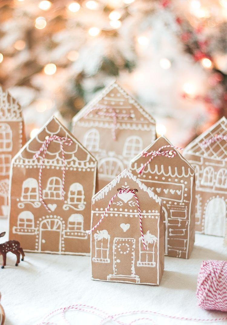 """<p>For Christmas, turn brown paper gift bags into a real work of art with the help of a paint pen and baker's twine. </p><p>Get the tutorial at <a href=""""https://www.craftberrybush.com/2015/12/gingerbread-house-paper-bag-gift-wrap-idea.html"""" rel=""""nofollow noopener"""" target=""""_blank"""" data-ylk=""""slk:Craftberry Bush"""" class=""""link rapid-noclick-resp"""">Craftberry Bush</a>.</p><p><a class=""""link rapid-noclick-resp"""" href=""""https://www.amazon.com/Paper-Lunch-Grocery-Durable-Kraft/dp/B07RWRBZKL?tag=syn-yahoo-20&ascsubtag=%5Bartid%7C10072.g.34015639%5Bsrc%7Cyahoo-us"""" rel=""""nofollow noopener"""" target=""""_blank"""" data-ylk=""""slk:SHOP PAPER BAGS"""">SHOP PAPER BAGS</a></p>"""