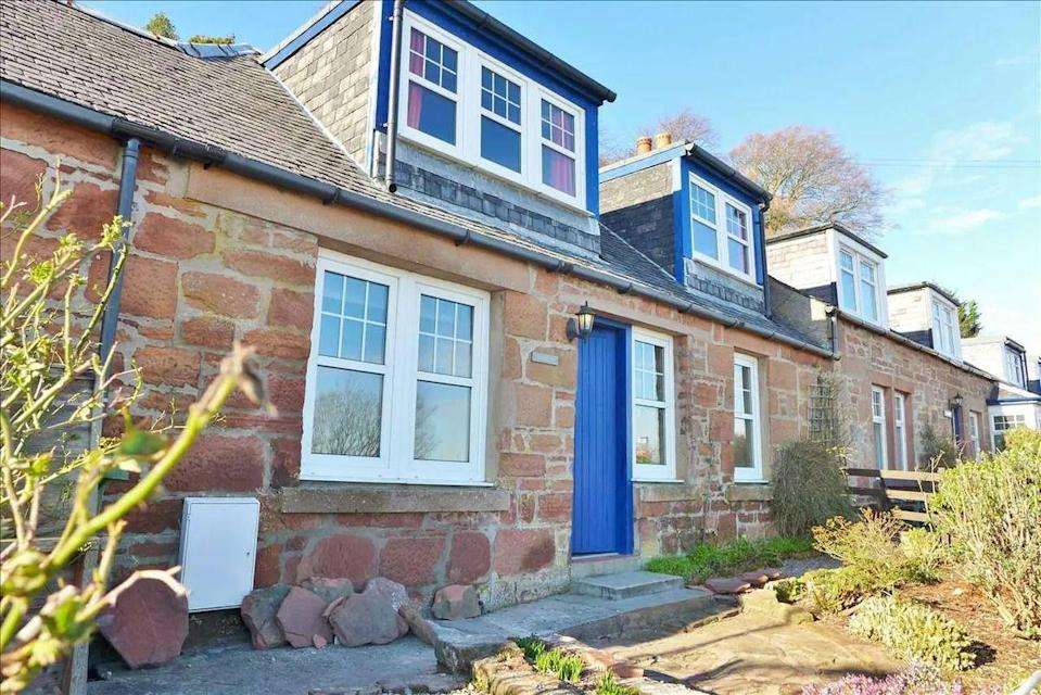 """<p>With uninterrupted sea views, this well-maintained property is the ultimate seaside <a href=""""https://www.housebeautiful.com/uk/lifestyle/property/g36107053/airbnb-cottages/"""" rel=""""nofollow noopener"""" target=""""_blank"""" data-ylk=""""slk:cottage"""" class=""""link rapid-noclick-resp"""">cottage</a>. On the market for £215,000, the red sandstone property has a terraced garden, two double bedrooms and a kitchen with sea views. </p><p><a href=""""https://www.zoopla.co.uk/for-sale/details/58330511/"""" rel=""""nofollow noopener"""" target=""""_blank"""" data-ylk=""""slk:This property is currently on the market for £215,000 with Arran Estate Agents via Zoopla"""" class=""""link rapid-noclick-resp"""">This property is currently on the market for £215,000 with Arran Estate Agents via Zoopla</a>. </p>"""
