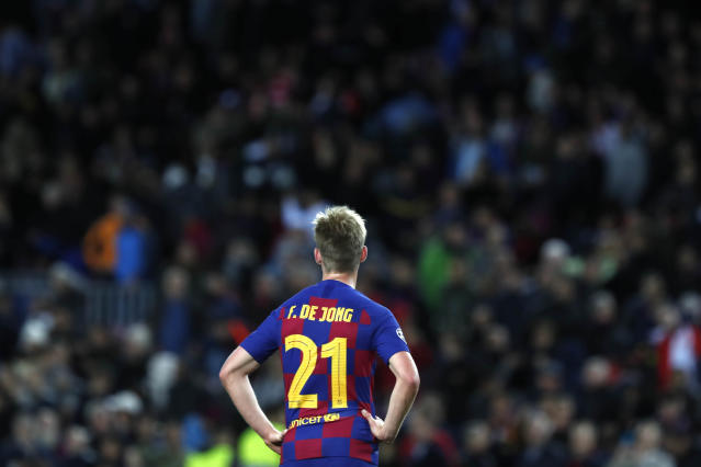 Barcelona's Frenkie de Jong stands on the pitch at the end of the Champions League Group F soccer match between Barcelona and Slavia Praha at Camp Nou stadium in Barcelona, Spain, Tuesday, Nov. 5, 2019. Barcelona was held to a 0-0 draw by Slavia Prague in the Champions League group phase on Tuesday. (AP Photo/Joan Monfort)