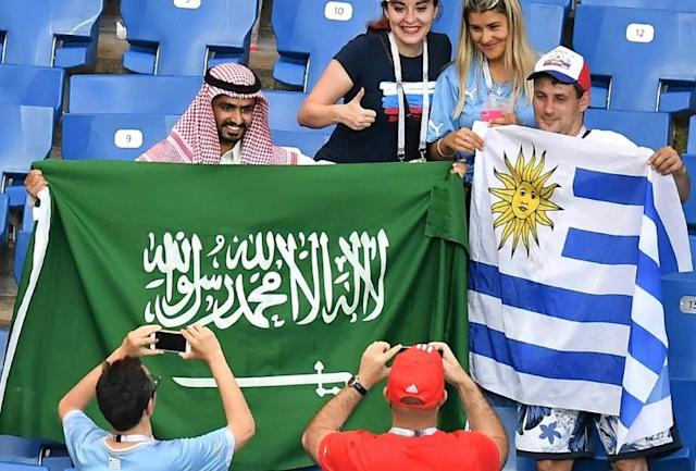 Uruguay and Saudi Arabia supporters get to know each other before their teams' Group A clash
