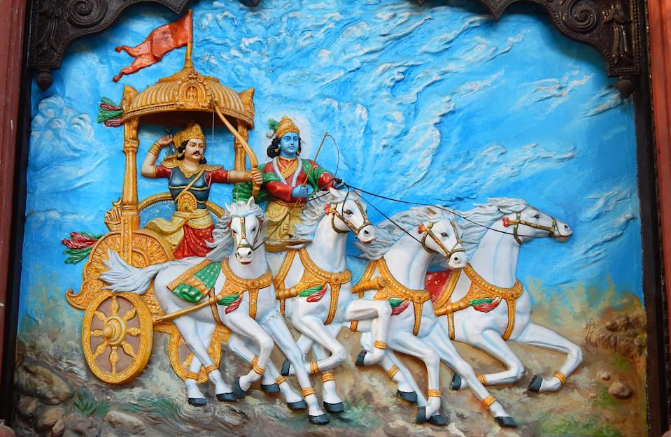 Wall art of Hindu God Krishna as charioteer and Arjuna as warrior in Mahabharata war as is in Hindu epic Mahabharat or Mahabharat in Ramkrishna math on March 19,2017 in Hyderabad,India