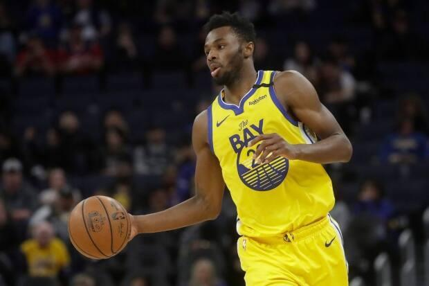 Golden State Warriors forward Andrew Wiggins has taken centre stage in the NBA's ongoing debate over COVID-19 vaccination. (Jeff Chiu/The Associated Press - image credit)