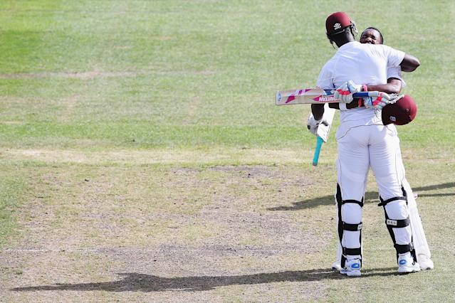 DUNEDIN, NEW ZEALAND - DECEMBER 06: Darren Bravo of the West Indies celebrates scoring 200 runs with Darren Sammy during day four of the first test match between New Zealand and the West Indies at University Oval on December 6, 2013 in Dunedin, New Zealand. (Photo by Hannah Johnston/Getty Images)