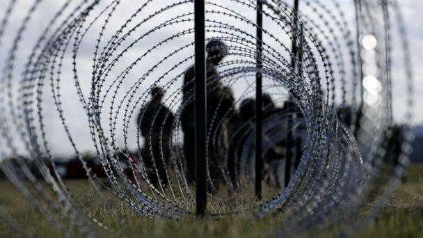 PHOTO: In this Nov. 3, 2018, file photo, members of the U.S. Army build a razor wire fence around area for tents near the U.S.-Mexico International bridge, in Donna, Texas. (AP Photo/Eric Gay)