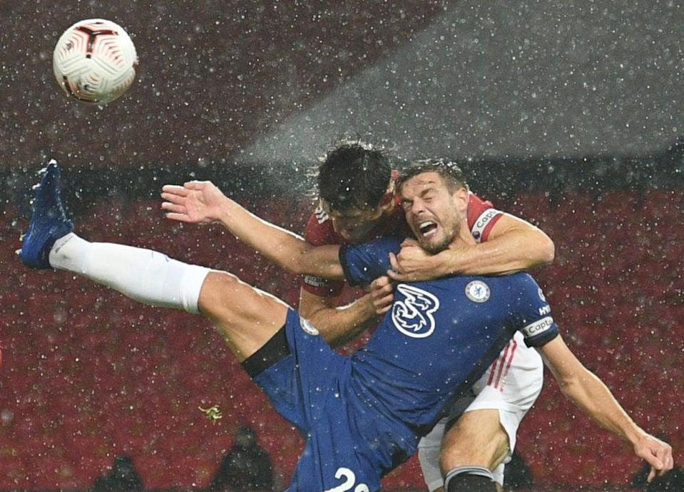 Cesar Azpilicueta wanted a penalty for Maguire's attempts to mark him (POOL/AFP via Getty Images)