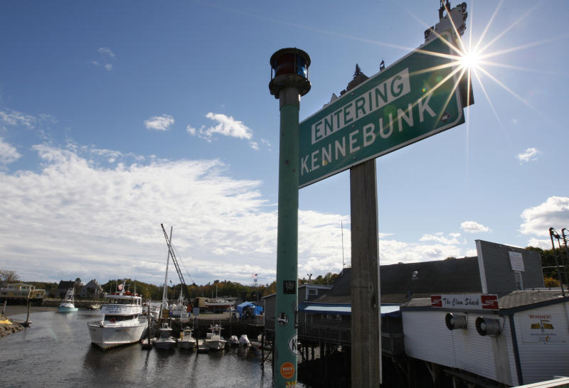 FILE - In this Oct. 12, 2012 file photo, a sign is seen near a marina in Kennebunk, Maine. The first batch of more than 100 men accused of paying a fitness instructor for sex were laying low after police began releasing their names in the small New England town where rumors have run rampant for weeks. Police on Monday released 21 names of men who were issued summons for engaging in prostitution with a 29-year-old Zumba instructor who's charged with turning her dance studio into a brothel in this seaside community and secretly videotaping her encounters. (AP Photo/Robert F. Bukaty, File)