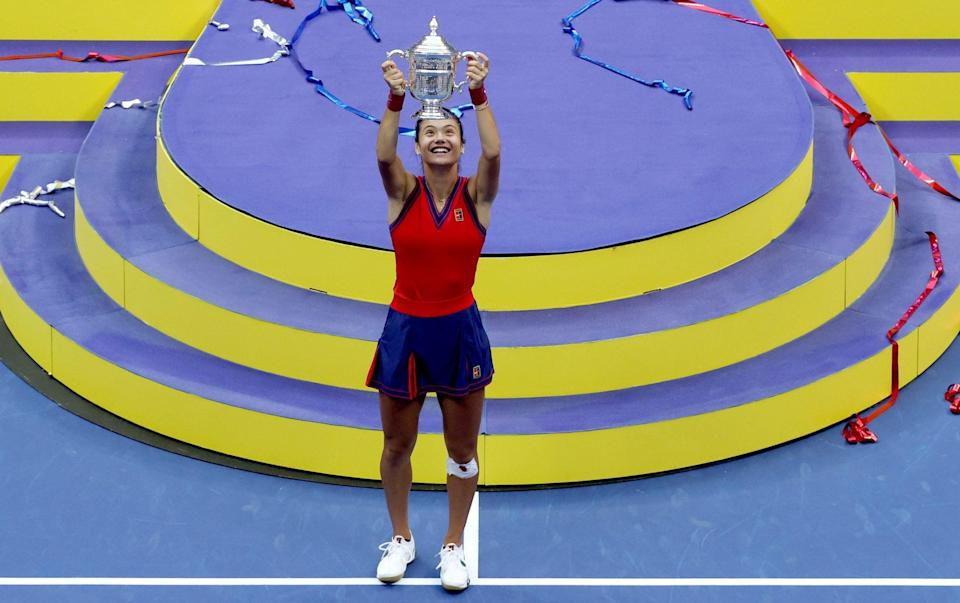 Emma Raducanu of Great Britain celebrates with the championship trophy after defeating Leylah Annie Fernandez of Canada during their Women's Singles final match on Day Thirteen of the 2021 US Open at the USTA Billie Jean King National Tennis Center on September 11, 2021 in the Flushing neighborhood of the Queens borough of New York City. - GETTY IMAGES