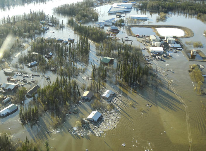 In this May 27, 2013 photo released by the National Weather Service, homes and other buildings are shown flooded in Galena, Alaska. Several hundred people are estimated to have fled the community of Galena in Alaska's interior, where a river ice jam has caused major flooding, sending water washing over roads and submerging buildings. (AP Photo/National Weather Service, Ed Plumb)