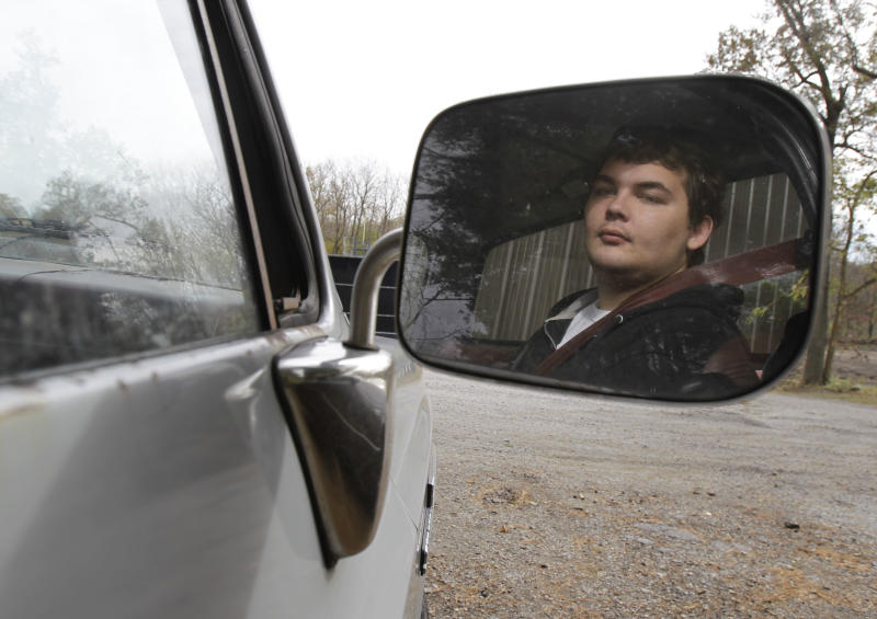 Twenty-two year old Cameron Dunn waits in his step-father Ron Holladay's truck while Holladay goes to work in Battle Ground, Ind., Wednesday, Oct. 27, 2010. Dunn suffers epilepsy, autism, and attention deficit hyperactivity disorder. His mother Becky Holladay says that when she called Indiana's Bureau of Developmental Disabilities Services to ask about a Medicaid waiver to pay for services that support disabled people living independently, a bureau worker told her that leaving severely disabled people at homeless shelters is one option families have if they can't be cared for at home. (AP Photo/Darron Cummings)