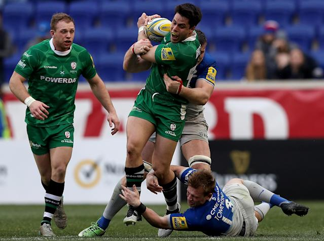 HARRISON, NJ - MARCH 12: Sean Maitland #15 of London Irish carries the ball as Nick Tompkins #13 of Saracens defends during the Aviva Premiership match on March 12, 2016 at Red Bull Arena in Harrison, New Jersey.Greig Tonks #10 of London Irish runs by. (Photo by Elsa/Getty Images)