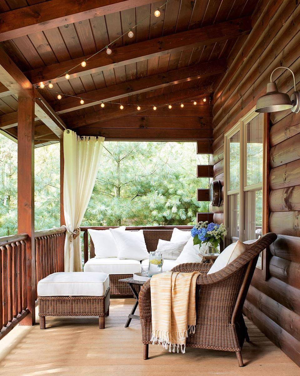<p>Set off a wood balcony with wicker furniture, outfitted with bright white cushions for an inviting look. </p>