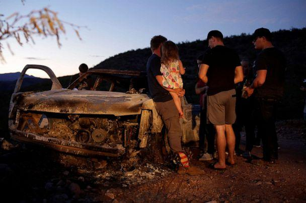PHOTO: Relatives of slain members of Mexican-American families belonging to Mormon communities observe the burnt wreckage of a vehicle where some of their relatives died, in Bavispe, Sonora state, Mexico Nov. 5, 2019. (Jose Luis Gonzalez/Reuters)