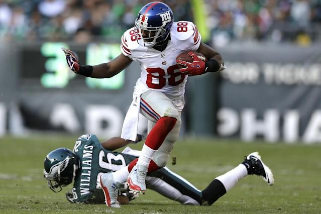 New York Giants wide receiver Hakeem Nicks (88) runs from Philadelphia Eagles' Cary Williams (26) during the second half of an NFL football game Sunday, Oct. 27, 2013, in Philadelphia. (AP Photo/Matt Rourke)