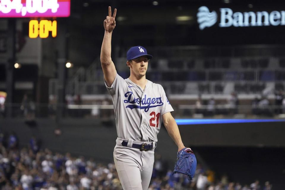 Los Angeles Dodgers pitcher Walker Buehler acknowledges fans while leaving in the eighth inning.