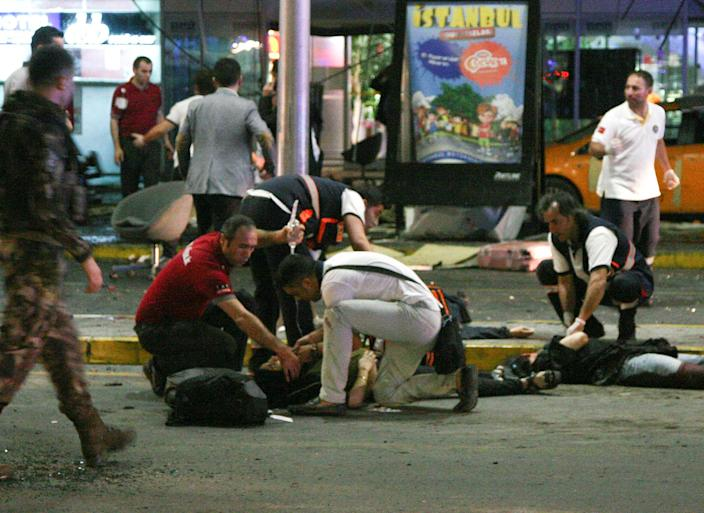 <p>Paramedics attend to casualties injured outside Turkey's largest airport, Istanbul Ataturk, Turkey, following an attack, June 28, 2016. (REUTERS/Stringer) </p>