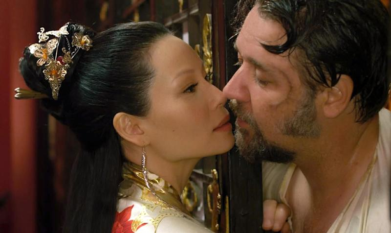 """This image released by Universal Pictures shows Lucy Liu, left, and Russell Crowe in a scene from """"The Man With the Iron Fists.""""  (AP Photo/Universal Pictures)"""