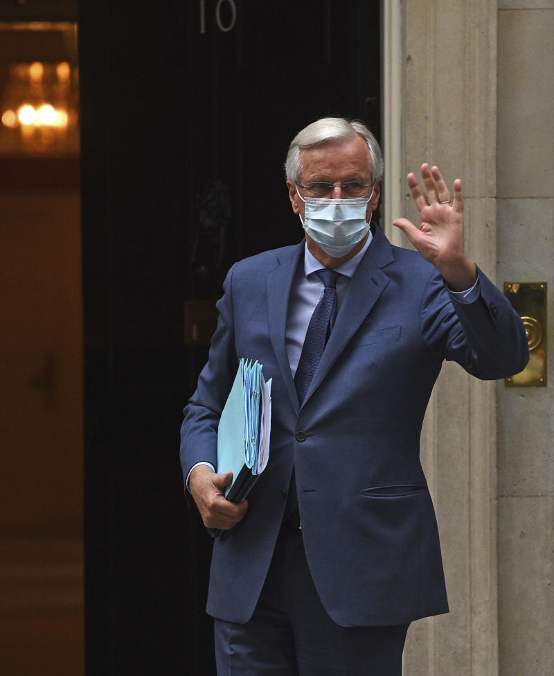 The European Union's Chief Brexit Negotiator Michel Barnier arrives at 10 Downing Street, where he and his UK counterpart David Frost, will begin the latest round of trade-deal talks, in London, Tuesday July 7, 2020. (Kirsty O'Connor/PA via AP)