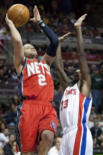New Jersey Nets' Jordan Farmar (2) shoots against Detroit Pistons' Walker Russell in the first half of an NBA basketball game on Friday, Feb. 10, 2012, in Auburn Hills, Mich. (AP Photo/Duane Burleson)