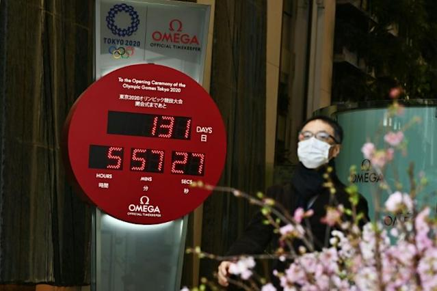 On Sunday, the Olympic countdown clock in Ginza in Tokyo showed 131 days before the Games are scheduled to start (AFP Photo/CHARLY TRIBALLEAU)