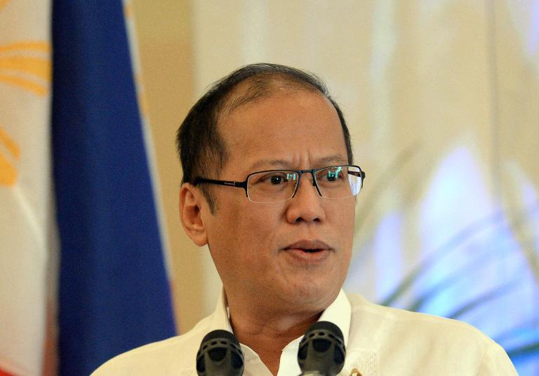 Philippine President Benigno Aquino delivers a speech during a forum in Manila, on October 23, 2013