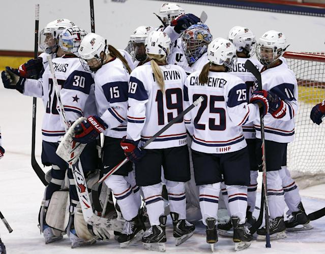 U.S. players gather after their 10-0 win over Sweden in a Four Nations Cup women's hockey game Tuesday, Nov. 5, 2013, in Lake Placid, N.Y. (AP Photo/Mike Groll)