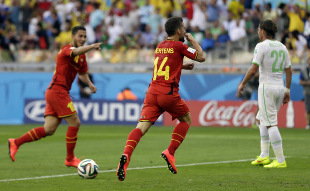 Belgium's Dries Mertens, center, celebrates after scoring his side's second goal during the group H World Cup soccer match between Belgium and Algeria at the Mineirao Stadium in Belo Horizonte, Brazil, Tuesday, June 17, 2014. (AP Photo/Ricardo Mazalan)