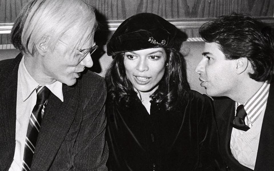 Bianca Jagger, journalist Bob Colacello, and Andy Warhol in the 70s - Getty
