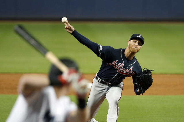 Atlanta Braves' Mike Foltynewicz, right, pitches to Miami Marlins' Garrett Cooper during the first inning of a baseball game, Sunday, Aug. 11, 2019, in Miami. (AP Photo/Wilfredo Lee)