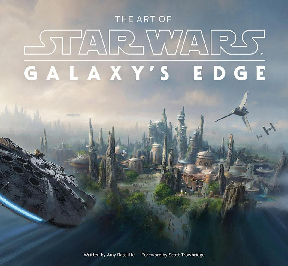 The Millennium Falcon flies into Black Spire Outpost on the cover of Art of Star Wars: Galaxy's Edge