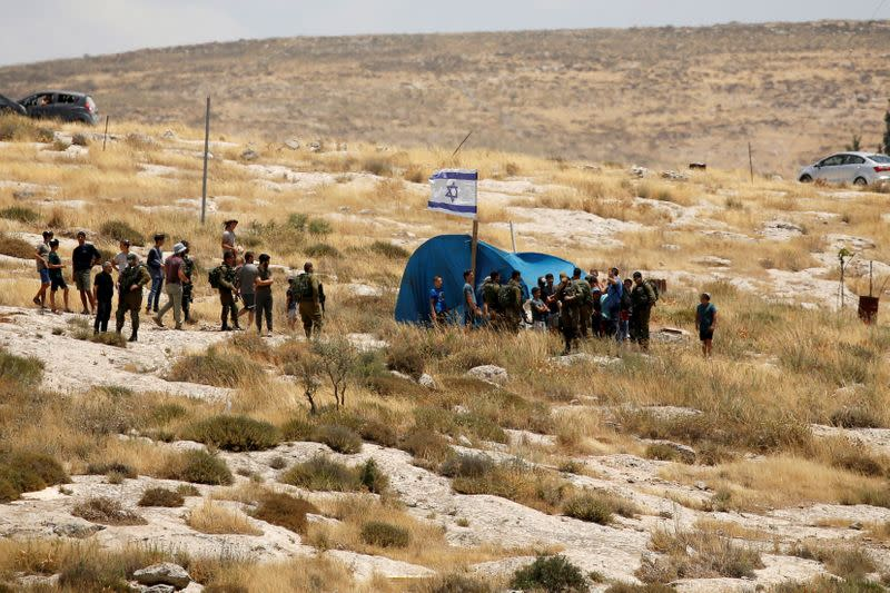 FILE PHOTO: Palestinians protest against Israel's plan to annex parts of the occupied West Bank