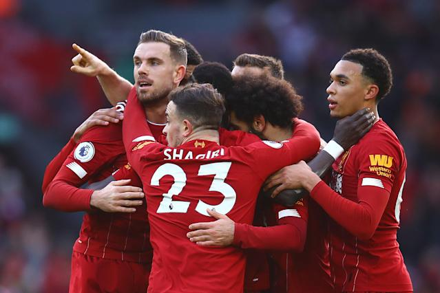 Mohamed Salah of Liverpool is congratulated by his team-mates. (Credit: Getty Images)