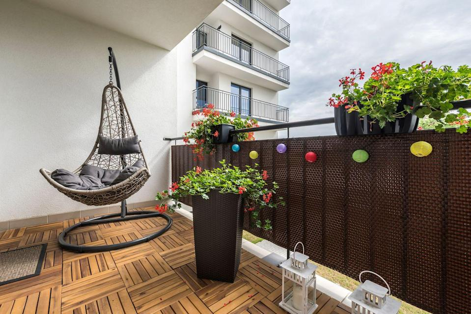 <p>Thanks to a woven swing chair and playful globe lights, you can transform your balcony into a relaxing oasis.</p>