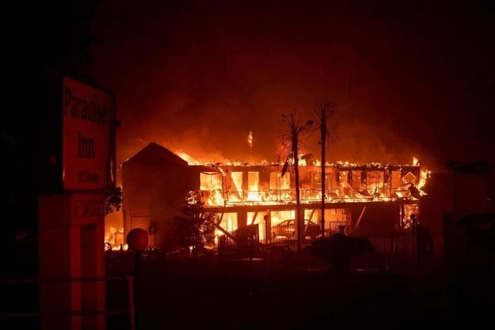 (FILES) In this file photo taken on November 9, 2018 the Paradise Inn hotel burns as the Camp Fire tears through Paradise, North of Sacramento, California. - California utility PG&E has agreed to pay $1 billion to 14 local government bodies for damage from wildfires blamed on the firm's equipment. The settlement announced on June 18, 2019 covers claims stemming from the 2018 Camp Fire in Northern California, which killed 85 people and destroyed some 18,000 buildings, and the earlier 2017 North Bay and 2015 Butte fires.In May, California's fire protection agency determined that PG&E's electrical power lines sparked Camp Fire, the deadliest in the state's history. (Photo by Josh Edelson / AFP)JOSH EDELSON/AFP/Getty Images ** OUTS - ELSENT, FPG, CM - OUTS * NM, PH, VA if sourced by CT, LA or MoD **