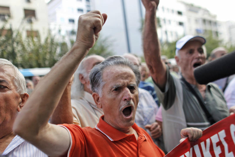 A pensioner shouts slogans during an anti-austerity protest in front of the EU headquarters in Athens on Monday, Oct. 8, 2012. The 17 eurozone ministers will look Monday at Greece's budget proposals. They will hear from the troika — the European Commission, the European Central Bank and the International Monetary Fund — about its negotiations with the Greek government. No final troika report will be submitted, so no decision on a new payout of aid will be made.(AP Photo)