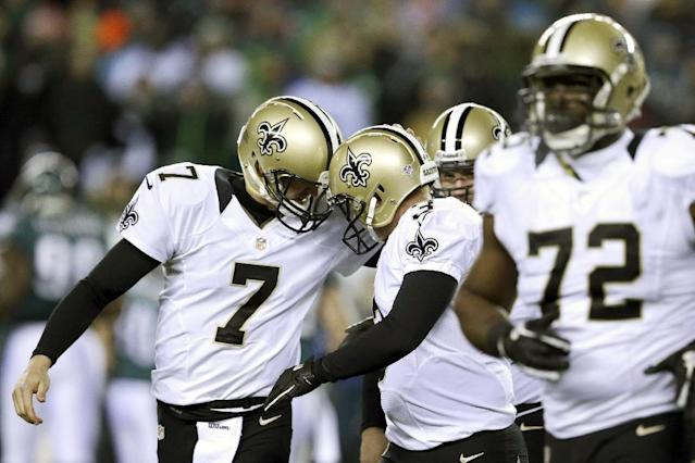New Orleans Saints' Luke McCown (7) celebrates with Shayne Graham (3) after Graham's field goal during the first half of an NFL wild-card playoff football game against Philadelphia Eagles, Saturday, Jan. 4, 2014, in Philadelphia. (AP Photo/Julio Cortez)