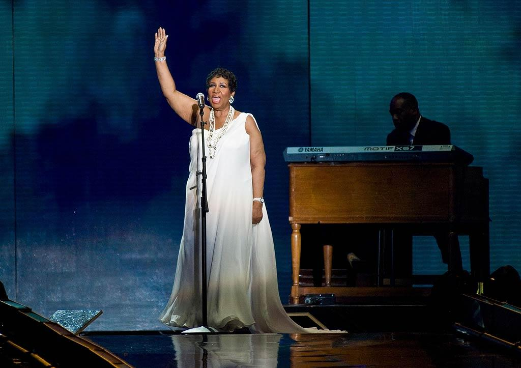 "The Queen of Soul celebrated the Queen of Talk! Aretha Franklin brought the crowd to their feet with her rendition of ""Amazing Grace."" Timothy Hiatt/<a href=""http://www.filmmagic.com/"" target=""new"">FilmMagic.com</a> - May 17, 2011"