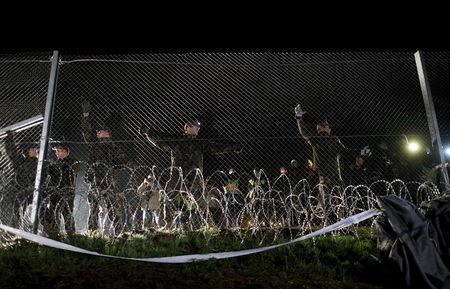 Hungarian soldiers close a border with Croatia near the village of Botovo, Croatia in this October 17, 2015 file photo. REUTERS/Antonio Bronic/Files