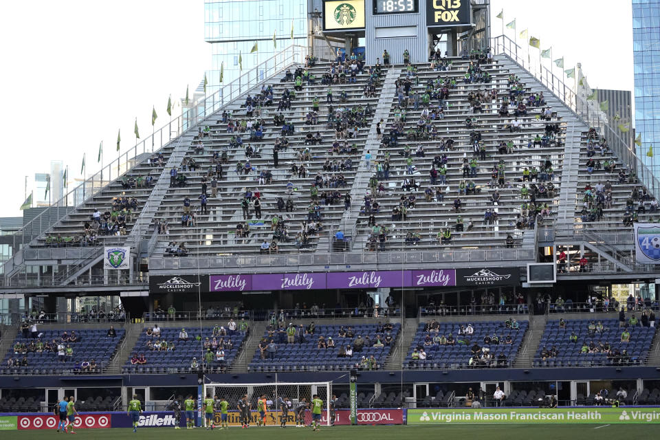 The Seattle Sounders and Minnesota United play in front of socially distanced fans at Lumen Field during the first half of an MLS soccer match Friday, April 16, 2021, in Seattle. (AP Photo/Ted S. Warren)