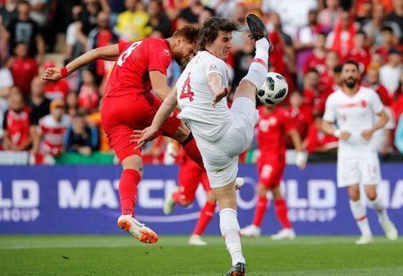 Soccer Football - International Friendly - Tunisia vs Turkey - Stade de Geneve, Geneva, Switzerland - June 1, 2018 Tunisia's Fakhereedine Ben Youssef in action with Turkey's Caglar Soyuncu REUTERS/Denis Balibouse